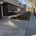 finished plaza, landscape area, and sidewalk